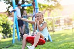 Joyful family having fun on playground royalty free stock photography