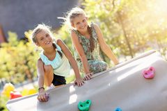 Joyful children having fun on playground Royalty Free Stock Images