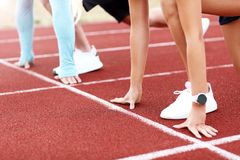 Man and woman racing on outdoor track Royalty Free Stock Photos