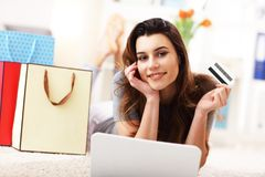 Pretty woman shopping online with credit card. Picture showing pretty woman shopping online with credit card Royalty Free Stock Images