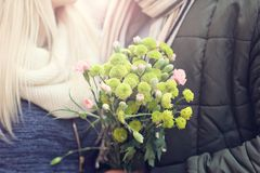 Picture showing young couple with flowers dating in the city Royalty Free Stock Photos