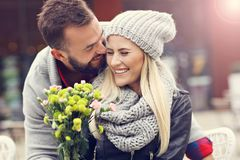 Picture showing young couple with flowers dating in the city Royalty Free Stock Images