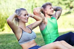 Young couple jogging in park Royalty Free Stock Images