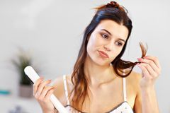Young woman standing in bathroom in the morning. Picture showing young woman looking in bathroom mirror royalty free stock photography
