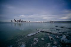 The dark blue waters of Mono Lake California. This picture shows the blue cloudy sky above the dark waters of Mono Lake in California royalty free stock photos
