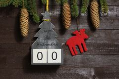 The christmas countdown. The picture shows a christmas countdown with the german text days until christmas stock photos