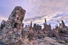 A cloudy blue sky behind salt rocks in Mono Lake. This picture shows a cloudy blue sky behind salt rocks in Mono Lake stock photos