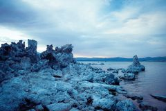 Blue salt formations in Mono Lake. This picture shows a cloudy sky over the rock formations in Mono Lake California stock images