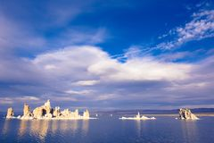 Blue cloudy skies above Mono Lake. This picture shows the famous Mono Lake salt rock formations and the blue sky above it stock photography