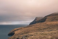 A field overlooking the cliffs in the faroe islands. This picture shows a field overlooking the cliffs in the faroe islands Stock Images
