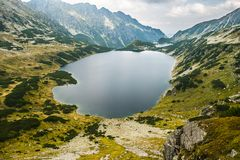 A lake high in the mountains stock photo