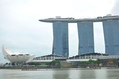 Marina Bay panorama and beautiful buildings in Singapore. The picture shows a luxury hotel Marina Bay Sands, a luxury shopping mall The Shoppes and the flowery Royalty Free Stock Photography