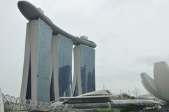 Marina Bay panorama and beautiful buildings in Singapore. The picture shows a luxury hotel Marina Bay Sands, a luxury shopping mall The Shoppes and the flowery Stock Images