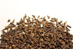 Many cloves on a white background stock image
