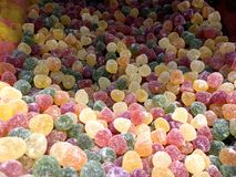 Multicolored sweets and figured candies. The picture shows Multicolored sweets and figured candies Stock Images