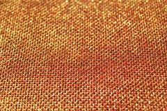 Red glittery jute background. The picture shows a red glittery jute background royalty free stock photography