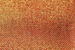 Red glittery jute background. The picture shows a red glittery jute background royalty free stock photo