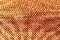 Red glittery jute background. The picture shows a red glittery jute background stock photography