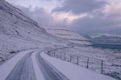A snow covered road in the faroe islands. This picture shows a snow covered road in the faroe islands Royalty Free Stock Image