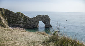 Waters and meadows, Durdle Door, England. The picture shows some blue waters and meadows in Durdle Door in Dorset, England Royalty Free Stock Image