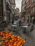 A street in Rouen, France - oranges. The picture shows a street in Rouen, France. It was taken on a gloomy day.There are some bright oranges visible in the stock photography