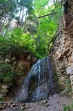 Azure waterfall in the rocks royalty free stock photography