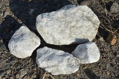 White stones on the ground. This picture shows white stones on the ground royalty free stock photography