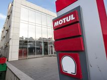 Motul logo on their retailer for Serbia. Motul is a French brand of motor oil and lubricants for automobile and motorbikes. Picture of a sign with the Motul logo royalty free stock images