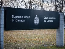 Entry sign indicating the Supreme Court of Canada, in Ottawa, Ontario. Also known as SCOC, it`s the highest justice body of Canada. Picture of the sign showing royalty free stock photo