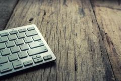 Picture of a silver keyboard on wood table. Picture of a silver keyboard on wood table stock image