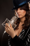 Picture of singer with studio microphone. Picture of beautiful singer with studio microphone stock photos