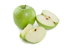 Picture of sliced green apples on the white background Stock Photos