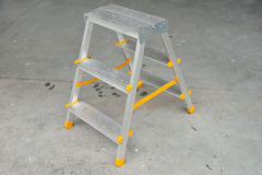 Picture of small foldable ladder on sidewalk. Picture of a small foldable ladder on sidewalk Stock Photos