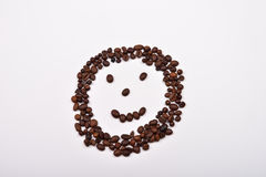 Picture of smiley face made of coffee beans on white backgroun Royalty Free Stock Images