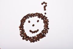 Picture of smiley face with question mark made of coffee beans Royalty Free Stock Photos