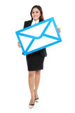 Picture of smiling businesswoman holding sign of envelope Royalty Free Stock Photography