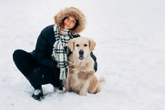 Picture of smiling girl with labrador in winter park Royalty Free Stock Photography