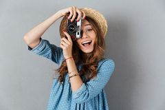 Smiling young caucasian woman photographer holding camera. Stock Photos