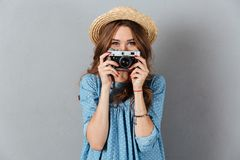 Smiling young caucasian woman photographer holding camera. Picture of smiling young caucasian woman photographer holding camera Royalty Free Stock Photography