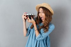 Smiling young caucasian woman photographer holding camera. Stock Photo
