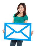 Picture of smiling young girl holding sign of envelope Stock Photos