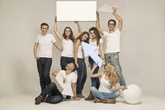 Picture of smiling young people with signs royalty free stock images