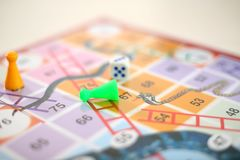 Picture of snakes and Ladders Game with tokens and dice stock photo