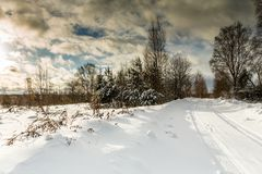 Picture of snowy landscape and cloudy sky. On winter day stock photography