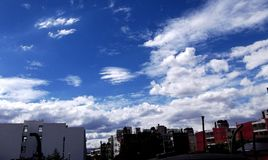White clouds and buildings over a clear blue sky in Mexico City. Picture of some buildings over a blue clouded sky on a sunny day in Mexico City stock photos