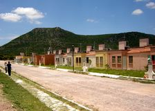 Small urban houses at Queretaro. Picture of some small houses with a mountain and blue sky background taken at San Juan del Río Queretaro, Mexico stock photos