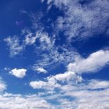 White clouds over a clear blue sky in Mexico City. Picture of some white clouds over a blue sky on a sunny day in Mexico City Royalty Free Stock Images