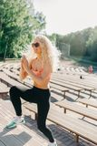 Picture of sports woman exercising among benches in summer day royalty free stock photos