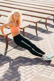 Picture of sports woman exercising among benches in summer day royalty free stock photo