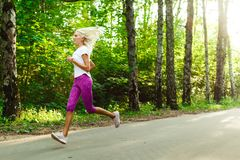 Picture of sports woman jogging on road Stock Photo